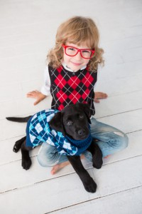 Hipster kid and dog. Child playing at home